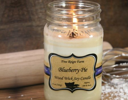 wood wick soy candle that smells like blueberry pie